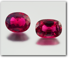 Robert Weldon - A pair of faceted natural ruby crystals
